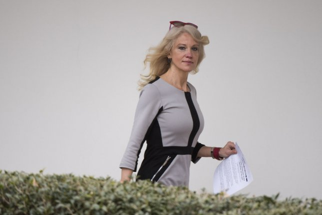 Kellyanne Conway, counselor to the president, walks on the Colonnade at the White House. Her husband George Conway III, has been nominated by President Donald Trump to fill a key Justice Department position. Photo by Kevin Dietsch/UPI