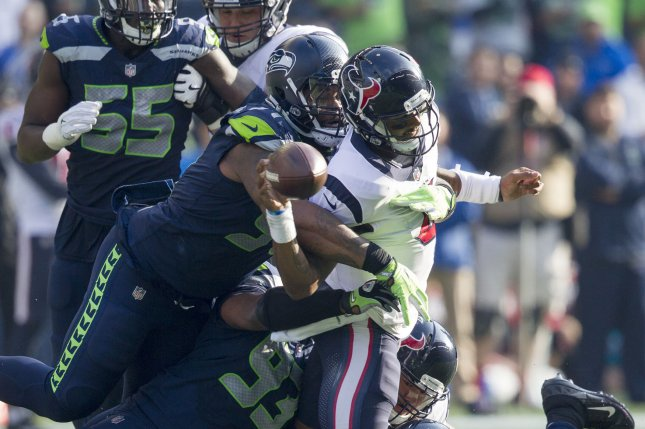 Houston Texans quarterback Deshaun Watson (4) loses the ball after getting sacked by Seattle Seahawks defensive tackle Sheldon Richardson (91) in the fourth quarter on October 29, 2017 at CenturyLink Field in Seattle, Washington. Photo by Jim Bryant/UPI