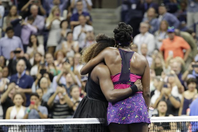 Serena Williams meets her sister Venus Williams at net after her straight sets victory in the third round in Arthur Ashe Stadium at the 2018 US Open Tennis Championships on Friday at the USTA Billie Jean King National Tennis Center in New York City. Photo by John Angelillo/UPI