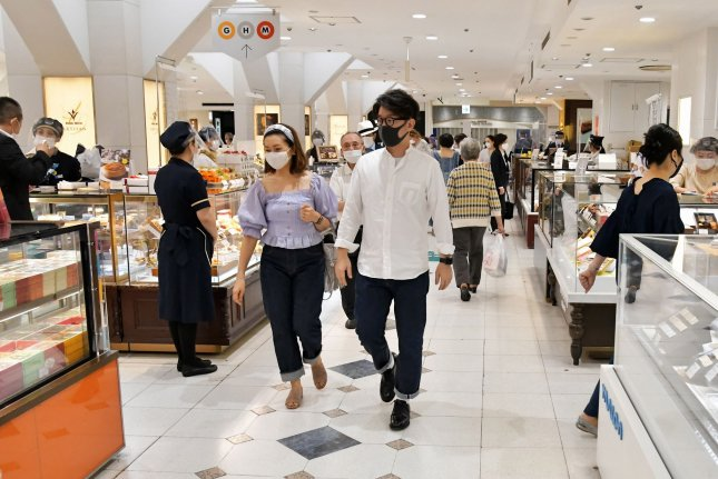 Customers wearing face masks are seen visiting the Matsuya Ginza department store which partially reopened in Tokyo on May 25. Tokyo recorded its largest number of new coronavirus cases Thursday. File Photo by Keizo Mori/UPI