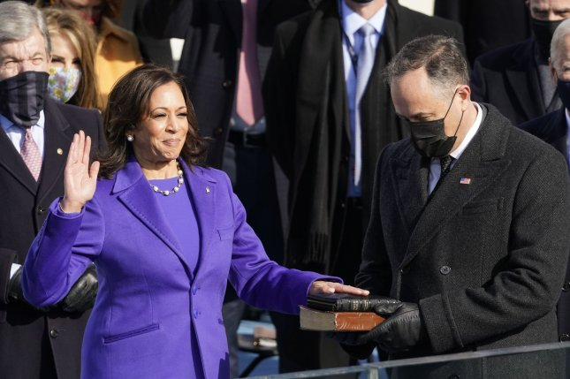 Kamala Harris (L) is sworn in as vice president by Supreme Court Justice Sonia Sotomayor as her husband Doug Emhoff holds the Bible at the U.S. Capitol in Washington, D.C., on Wednesday morning. Pool Photo by Andrew Harnik/UPI