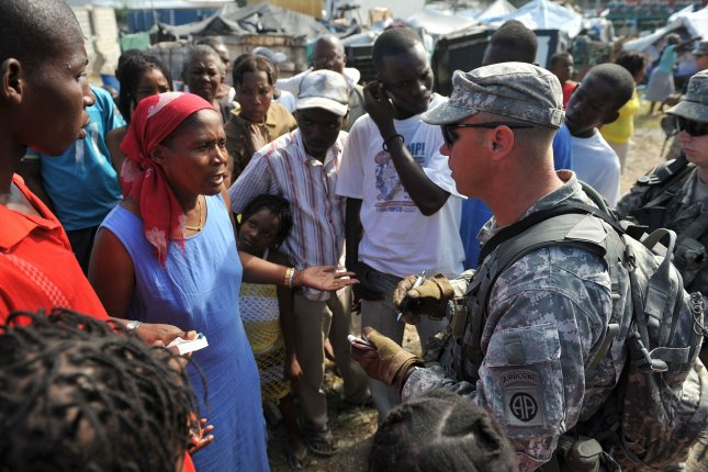 Sgt. Matthew White with the Black Falcon battalion of the 82nd Army Airborne talks to the leader of a refugee camp during an assessment visit in Port-au-Prince, Haiti on January 27, 2010. Haiti continues to suffer after a 7.0 magnitude earthquake devastated the country on January 12. UPI/Kevin Dietsch