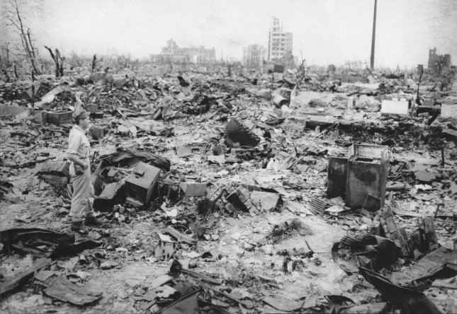 A war correspondent examines the rubble left after the city of Hiroshima was leveled by the atomic bomb dropped at exactly 8:15AM on August 6, 1945. (UPI Photo/Files)