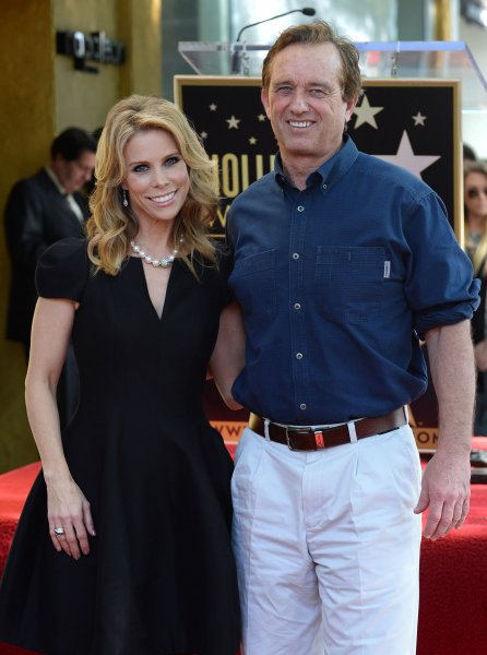 Actress Cheryl Hines and her beau Robert Kennedy Jr. pose during an unveiling ceremony honoring Hines with the 2,516th star on the Hollywood Walk of Fame in Los Angeles on January 29, 2014. UPI/Jim Ruymen