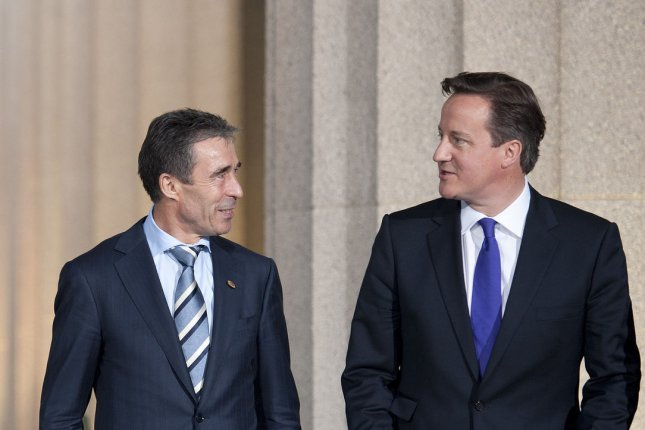 NATO Secretary General Anders Fogh Rasmussen (l) and British Prime Minister David Cameron at the 2012 NATO Summit in Chicago. (UPI/Brian Kersey)