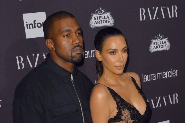 Kim Kardashian (R) and Kanye West at the Harper's Bazaar Icons party on September 9, 2016. File Photo by Andrea Hanks/UPI
