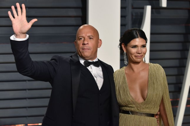Vin Diesel (L) and his wife Paloma Jimenez attend the Vanity Fair Oscar Party on February 26. Universal released a new trailer for The Fate of the Furious that features Diesel, Dwayne Johnson, Charlize Theron and Michelle Rodriguez. File Photo by Christine Chew/UPI