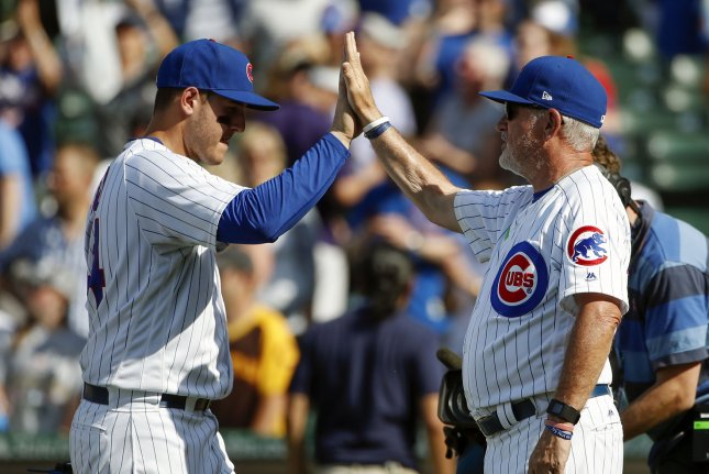 Chicago Cubs Anthony Rizzo (L) celebrates with manager Joe Maddon (R) their win against the Colorado Rockies at Wrigley Field on June 11, 2017 in Chicago. Photo by Kamil Krzaczynski/UPI