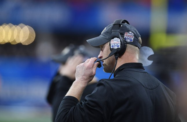 Former Central Florida coach Scott Frost paces the sidelinesduring the Chick-fil-A Peach Bowl against Auburn on Jan. 1. Frost accepted the coaching post at Nebraska. Photo by David Tulis/UPI