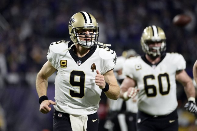 New Orleans Saints quarterback Drew Brees runs off the field after the first half of the NFC Divisional round playoff game against the Minnesota Vikings on January 14, 2018 at U.S. Bank Stadium in Minneapolis. Photo by Brian Kersey/UPI