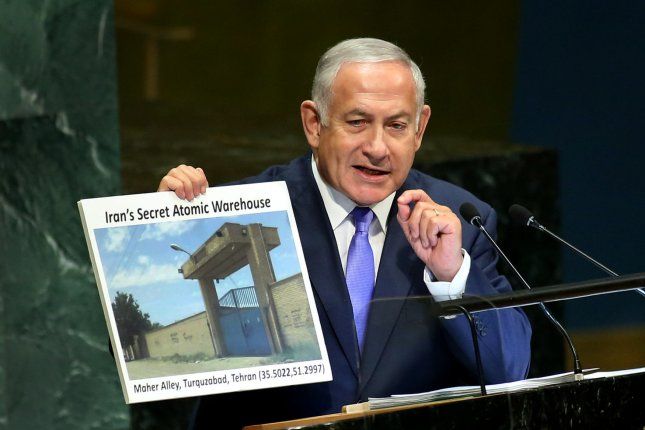 Israeli Prime Minister Benjamin Netanyahu holds a photo of Iran's alleged secret atomic warehouse is as he addresses the United Nations General Assembly in New York on Thursday. Photo by Monika Graff/UPI