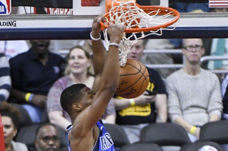 Dallas Mavericks guard Dennis Smith Jr. (1) scores on a dunk. File photo by Mark Goldman/UPI