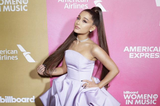 Ariana Grande uploaded to Instagram a photo of herself speaking with her estranged father. File Photo by John Angelillo/UPI