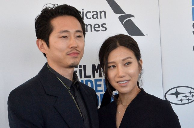 Steven Yeun (L), pictured with Joana Pak, welcomed his second child, a baby girl, with the photographer Tuesday. File Photo by Jim Ruymen/UPI