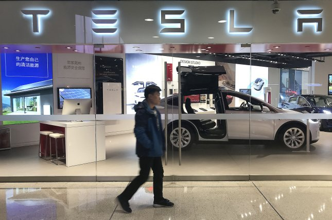 Chinese shoppers visit Tesla's new showroom in Beijing last February. Tesla delivered its first  Model 3 cars in China on Monday. Photo by Stephen Shaver/UPI