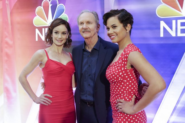 Sarah Wayne Callies, Michael O'Neill and Michele Weaver from Council of Dads arrive on the red carpet at the NBC Midseason New York Press Junket on January 23.  File Photo by John Angelillo/UPI