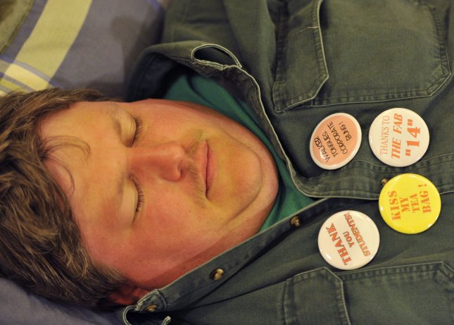 A protester sleeps in the state capitol in Madison, Wisconsin on February 23, 2011. Thousands are staging a 24-hour protest of the state budget proposed by Republican Gov. Scott Walker, which includes cuts in benefits for state workers and takes away many of their collective bargaining rights. UPI/Brian Kersey