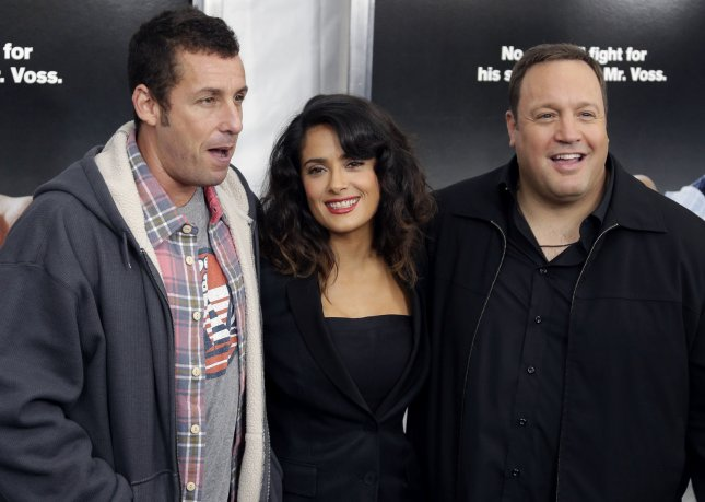 Kevin James, Salma Hayek and Adam Sandler arrive on the carpet at the 'Here Comes The Boom' premiere at the AMC Loews Lincoln Square in New York City on October 9, 2012. UPI/John Angelillo