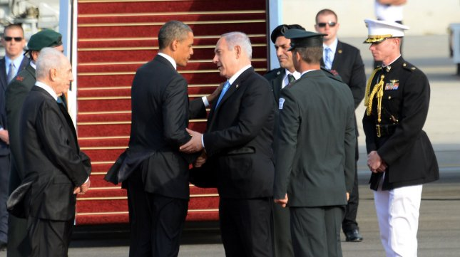 U.S. President Barack Obama and Israeli Prime Minister Benjamin Netanyahu say good-bye before Obama boards Air Force One to depart Israel at Ben Gurion Airport near Tel Aviv, March 22, 2013. President Obama wrapped up a three day visit to the Holy Land before flying to Jordan. UPI/Debbie Hill