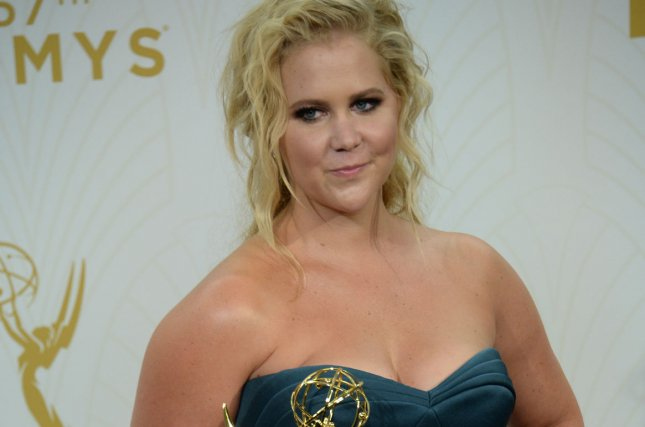 Amy Schumer holds her Emmy for Outstanding Variety Sketch Series for 'Inside Amy Schumer' at the 67th Primetime Emmy Awards in Los Angeles on Sept. 20, 2015. Photo by Jim Ruymen/UPI Schumer hosted this weekend's edition of Saturday Night Live.