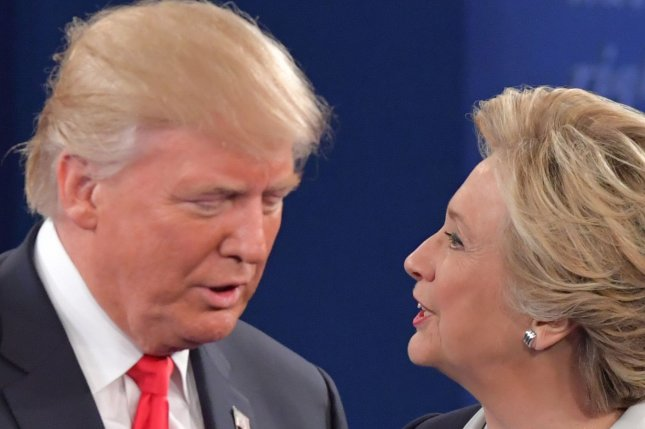 Hillary Clinton and Donald Trump were face-to-face at Sunday's debate. The UPI/CVoter daily online tracking poll shows Clinton's lead in the race is now at 6 percent nationally. Photo by Kevin Dietsch/UPI