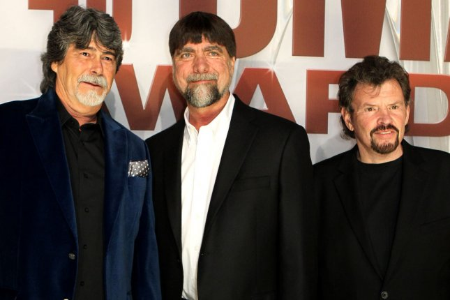 Alabama arrives on the red carpet at the 45th Annual Country Music Association Awards on November 9, 2011. The lengendary country band has been added to the list of performers for Dolly Parton's telethon. File Photo by Terry Wyatt/UPI