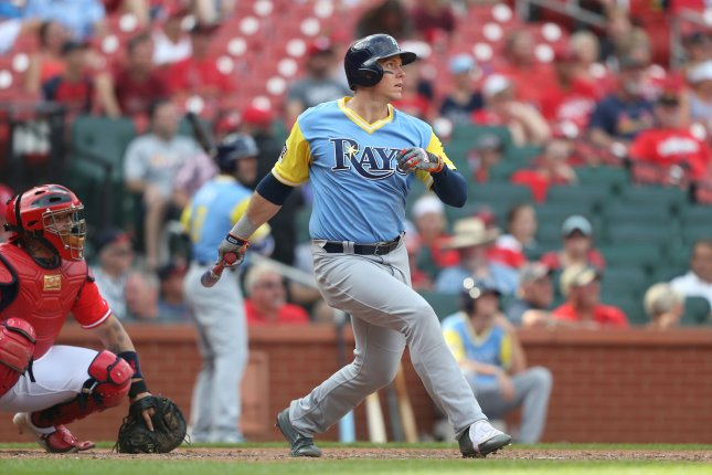 Tampa Bay Rays Logan Morrison follows the baseball, hitting a solo home run in the tenth inning against the St. Louis Cardinals at Busch Stadium in St. Louis on August 27, 2017. Tampa Bay won the game 3-2. Photo by Bill Greenblatt/UPI