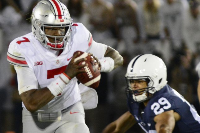 Ohio State quarterback Dwayne Haskins steps around Penn State cornerback John Reid to throw a 47-yard pass to Binjimen Victor for a touchdown in the fourth quarter of the 27-26 Buckeyes' victory at Beaver Stadium in State College , Pennsylvania on September 29, 2018. Photo by Archie Carpenter/UPI