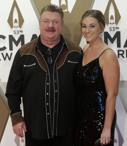 Joe Diffie -- pictured here with his wife Tara in November -- died Sunday at age 61. File Photo by John Angelillo/UPI