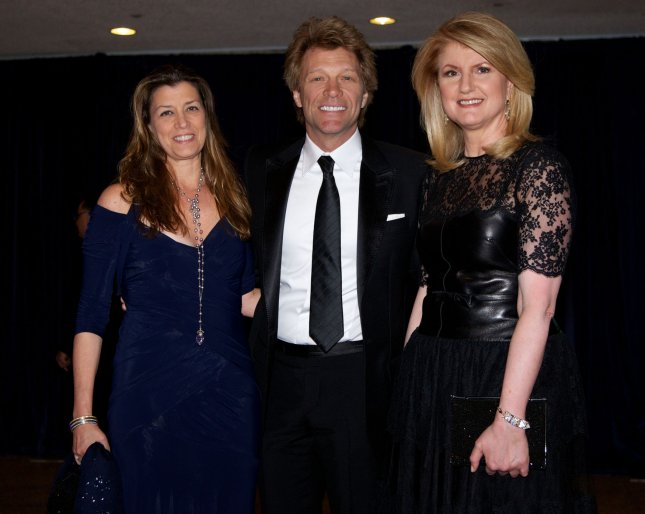 Jon Bon Jovi and his wife Dorothea Hurley post on red carpet with Arianna Huffington (Right) at the White House Correspondents' Association Dinner at the Washington Hilton in Washington, DC on April 27, 2012. UPI/Molly Riley