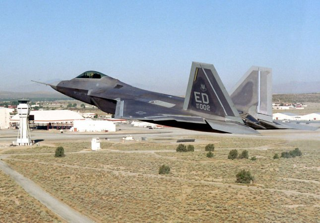 An F-22 Raptor makes a low pass here at Edwards AFB in California on October 24, 2003. The Air Force's new air superiority fighter is expected to dominate the future air combat arena by integrating advanced avionics, stealth and supercruise. (UPI/Brooke Davis/AFIE)