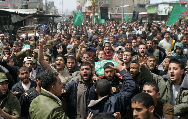 Palestinians carry the bodies of Hamas militants during their funeral in Rafah in the southern Gaza Strip ON April 8, 2011. UPI/Ismael Mohamad