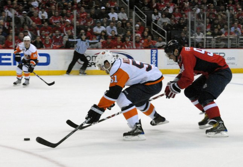 The New York Islanders' Frans Nielsen skates ahead of the Washington Capitals' Sergei Federov in an April 1, 2009, game in Washington. (UPI Photo/Alexis C. Glenn)