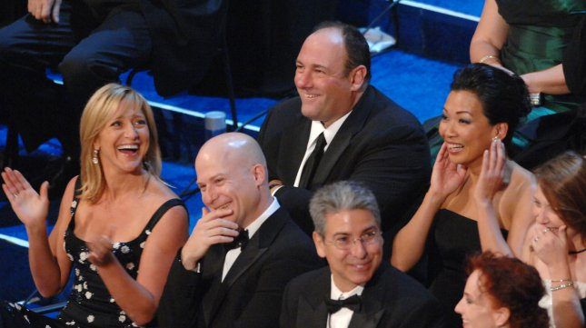 James Gandolfini (L) and wife Deborah Lin (R) react with cast members of the The Sopranos during the 59th Primetime Emmy Awards in Los Angeles on September 16, 2007. (UPI Photo/Jim Ruymen)
