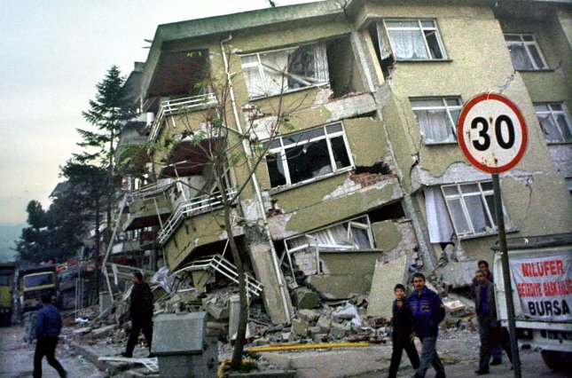 A semi-collapsed building stands along Istanbul Street in the town of Duzce, Turkey. The damage is the result of an earthquake measuring 7.2 on the Richter scale. UPI/Renga Subbiah