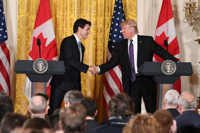 President Donald Trump shakes hands with Canadian Prime Minister Justin Trudeau during a joint press conference Monday in the East Room of the White House. The leaders spoke on a number of issues, including U.S.-Canada relations, trade and the Syrian refugee crisis. Photo by Pat Benic/UPI
