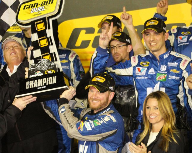 Dale Earnhardt Jr., Rick Hendrick (left) and fiancée Amy Reimann (lower right) celebrate winning the first of two Can-Am Duels at Daytona International Speedway on Feb. 18, 2016. Junior says if he gets a championship this year, Hell yeah he will retire. Mike Gentry/UPI