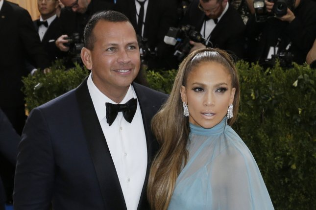 Alex Rodriguez (L) and Jennifer Lopez attend the Costume Institute Benefit at the Metropolitan Museum of Art on May 1. Lopez gave Rodriguez's daughter Natasha a high five and hug after the 12-year-old finished an at-home performance Thursday. File Photo by John Angelillo/UPI