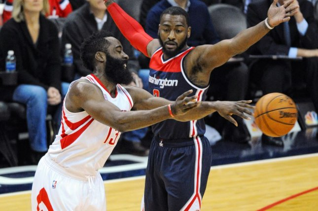 Houston Rockets guard James Harden (13) makes a pass against Washington Wizards guard John Wall (2) in the first half on November 7, 2016 at the Verizon Center in Washington, D.C. File photo by Mark Goldman/UPI
