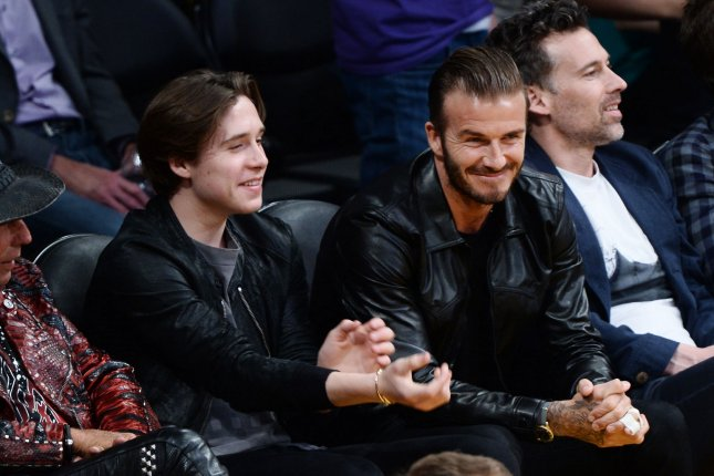 Brooklyn Beckham (L), pictured with David Beckham, surprised his dad on his 43rd birthday. File Photo by Jim Ruymen/UPI