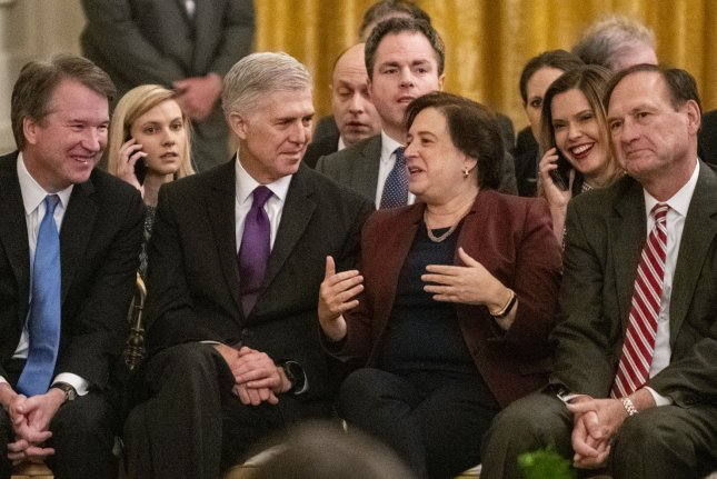 Supreme Court Justices Brett Kavanaugh (L), Neil Gorsuch, Elena Kagan and Samuel Alito have a conversation prior to the Medal of Freedom presentations by President Donald Trump during a ceremony in the East Room of the White House in Washington, D.C., on November 16, 2018. Photo by Pat Benic/UPI