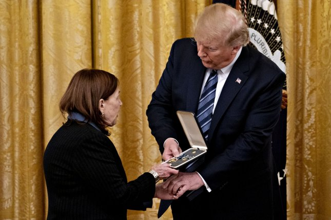 President Donald Trump presents the Presidential Citizens Medal to Susan Rescorla, wife of Richard Rescorla, at the White House on Thursday.  Richard Rescoria died while leading evacuations from the World Trade Center during the Sept. 11, 2001 terror attacks. Photo by Andrew Harrer/UPI