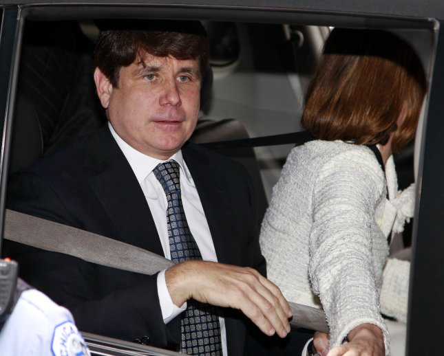 Former Illinois Gov. Rod Blagojevich leaves the federal court with his wife Patricia, (R) after hearing the verdict in his corruption trial on June 27, 2011 in Chicago. A federal jury found Blagojevich guilty on 17 of 20 charges Monday, including trying to peddle President Obama's vacant Senate seat. UPI/Kamil Krzaczynski