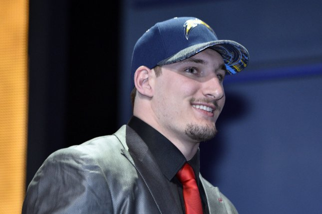 Ohio State defensive end Joey Bosa walks onto the stage after being selected by the San Diego Chargers with the third overall pick in the 2016 NFL Draft on April 28, 2016 in Chicago. Photo by Brian Kersey/UPI