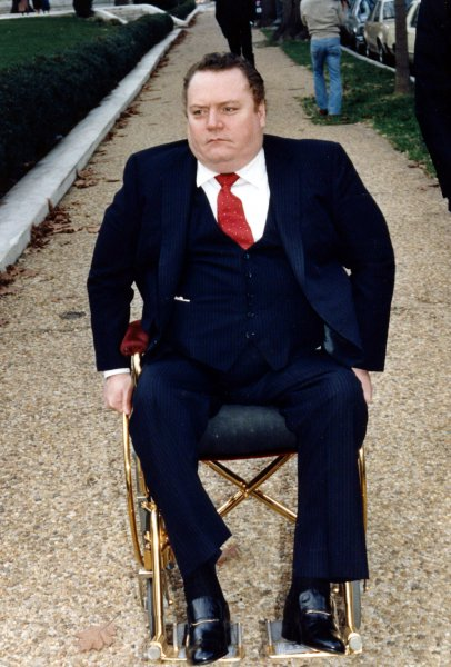 Hustler Magazine publisher Larry Flynt arrives at the Supreme Court on December 2, 1987. The court is reviewing the $200,000 award given to evangelist Jerry Falwell for emotional distress he suffered as a result of a parody of him that appeared in Hustler Magazine. File Photo by Leighton Mark/UPI