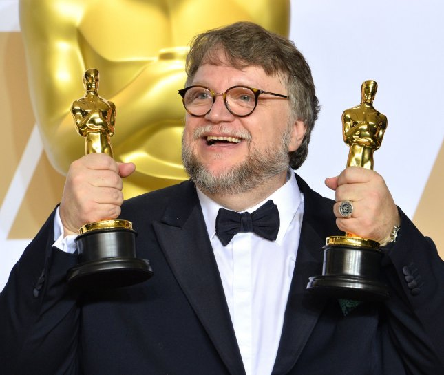 Filmmaker Guillermo del Toro, winner of the awards for Best Director and Best Picture for The Shape of Water, appears backstage with his Oscars during the 90th annual Academy Awards in Los Angeles on March 4. Photo by Jim Ruymen/UPI