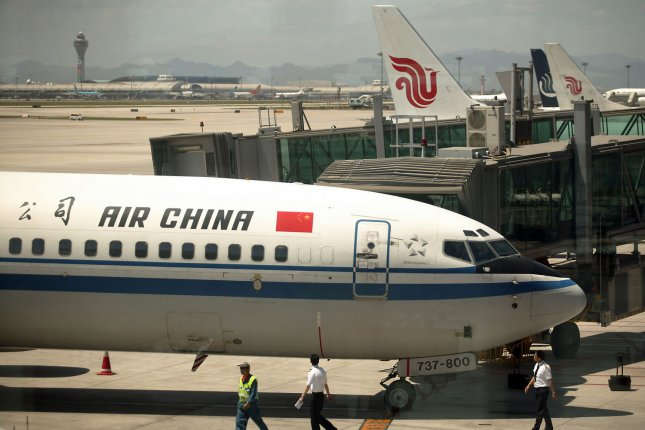 Pilots of an Air China flight from Hong Kong to Dalian this week are under investigation after the aircraft made a sudden decent of 25,000 feet over a period of 10 minutes. File Photo by Stephen Shaver/UPI