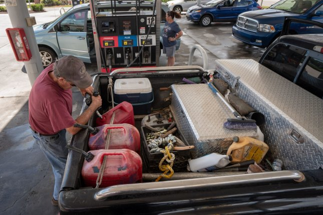 Mike Brown pumps gas into reserve tanks in preparation for approaching Hurricane Florence September 12, 2018 in Little River, South Carolina. Florence, a category 4 storm, is expected to hit the coast between South and North Carolina and could be the strongest storm on record for the East Coast of the United States. Photo by Ken Cedeno/UPI