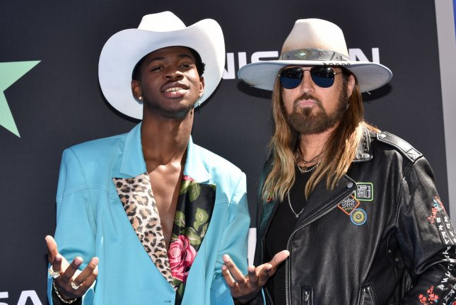 Billy Ray Cyrus (R) with Lil Nas X. Cyrus will be presenting an award at the 2019 MTV Video Music Awards, along with Jonathan Van Ness. File Photo by Chris Chew/UPI