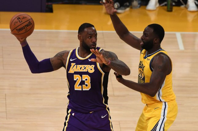 Los Angeles Lakers forward LeBron James (L) was criticized for standing on the court in his socks while cheering on his teammates toward the end of Wednesday's blowout win over the Utah Jazz. File Photo by Jon SooHoo/UPI